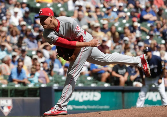 Cincinnati Reds starting pitcher Robert Stephenson throws during the first inning of a baseball game against the Milwaukee Brewers Wednesday, Aug. 22, 2018, in Milwaukee.
