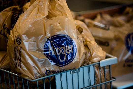 Kroger bags full of items sit in a cart at Kroger in Newport, Ky., on Wednesday, Aug. 22, 2018.