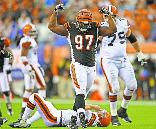 Sunday, Nov. 27, 2011 BENGALS SPORTS : Cincinnati Bengals defensive tackle Geno Atkins (97) reacts after sacking Cleveland Browns quarterback Colt McCoy (12)in the fourth quarter during their game at the Paul Brown Stadium. The Enquirer/Jeff Swinger