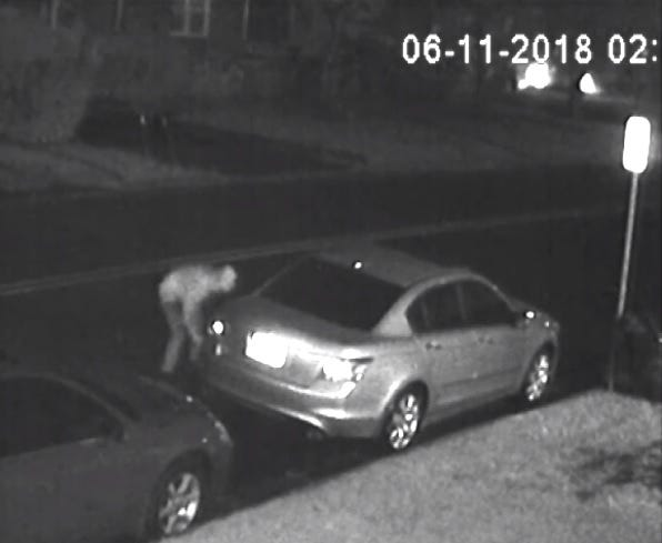A screengrab of surveillance camera footage capturing the suspected tire slasher in Manville.