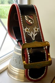 An antique cowbell decorated with edelweiss flowers and the coat of arms of Bern, Switzerland. Ernest Stalder, a Swiss immigrant to Ohio, founded the company renowned for their Swiss style cheeses in 1928.