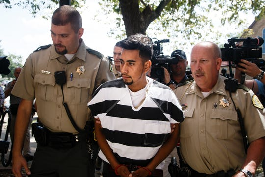 Cristhian Bahena Rivera, 24, has been charged with first-degree murder in Mollie Tibbetts' death. Here he is brought into the Poweshiek County Courthouse on Wednesday, Aug. 22, 2018 in Montezuma.