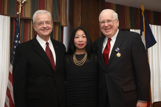Congressman Leonard Boswell, left, was a driving force in Kenneth Quinn, right, receiving the Army Air Medal. Also pictured is Quinn's wife, Le Son.