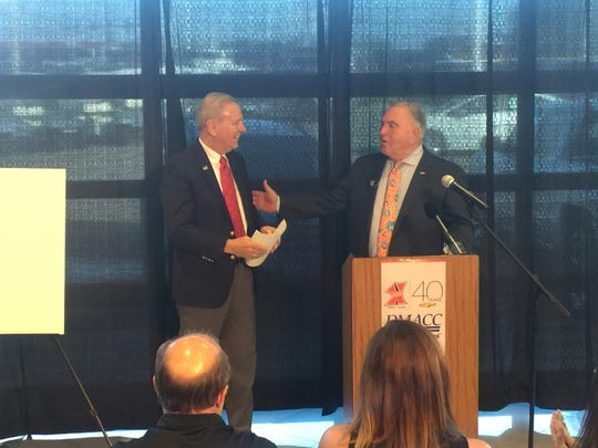Carl Moyer, right, of Karl Chevrolet in Ankeny, announces a $1 million donation to the Des Moines Area Community College to expand the Automotive Technology Center on the Ankeny DMACC campus.