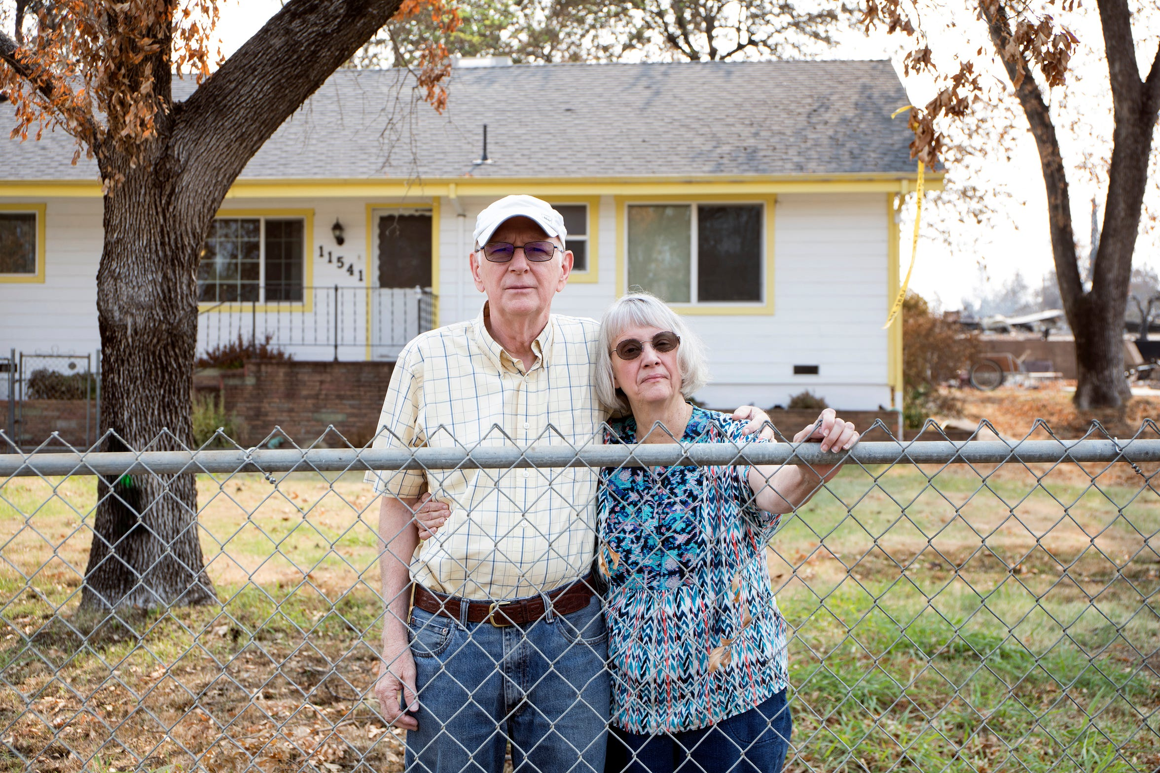 From left Jerry Thomas, 70 and his wife Barbara Thomas, 68 are photographed in front of their home following the Carr fire in Keswick, Calif., Tuesday, August 21, 2018.  Their home is one of only two remaining in their neighborhood which was in the heart of the tornado fire.