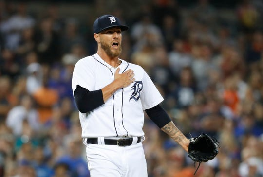 Detroit Tigers relief pitcher Shane Greene reacts to the final out in the ninth inning of a baseball game against the Chicago Cubs in Detroit, Tuesday, Aug. 21, 2018. Detroit won 2-1.