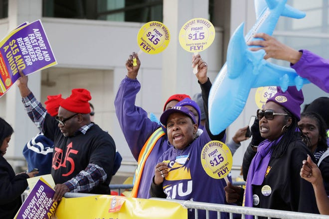 SEIU Local 1 union members protest for an increase in the minimum wage in November 2016 at the Detroit Metropolitan Airport in Romulus.