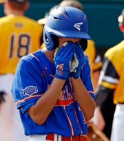 Grosse Pointe Woods-Shores' Brennan Hill walks off the field at Lamade Stadium after losing an elimination baseball game against Peachtree City, Georgia in United States pool play at the Little League World Series tournament in South Williamsport, Pa., Wednesday, Aug. 22, 2018. Georgia won 4-3, eliminating Michigan. (AP Photo/Gene J. Puskar)