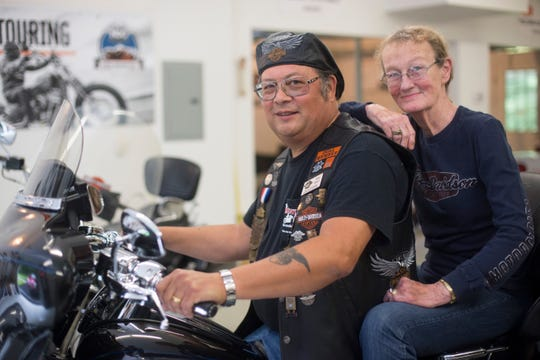 Tony Baker, 63, and his wife, Lucy Baker, 76, sit on his 2013 Anniversary Edition CVO Ultra at their Wells, Maine, home Wednesday. They will drive their own route to Milwaukee to help Harley-Davidson celebrate its 115th anniversary. The Bakers will deliver the chapter flag for the Southern Maine Portland Harley Owners Group.