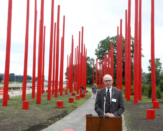 "Southfield mayor Kenson Siver speaks during opening day of Red Pole Park, located off the Lodge Freeway service drive in Southfield on Wednesday, August 22, 2018. The greenway is part of Southfield's efforts of outdoor ""rooms"" or art installations on a bike, run and walk pathway."