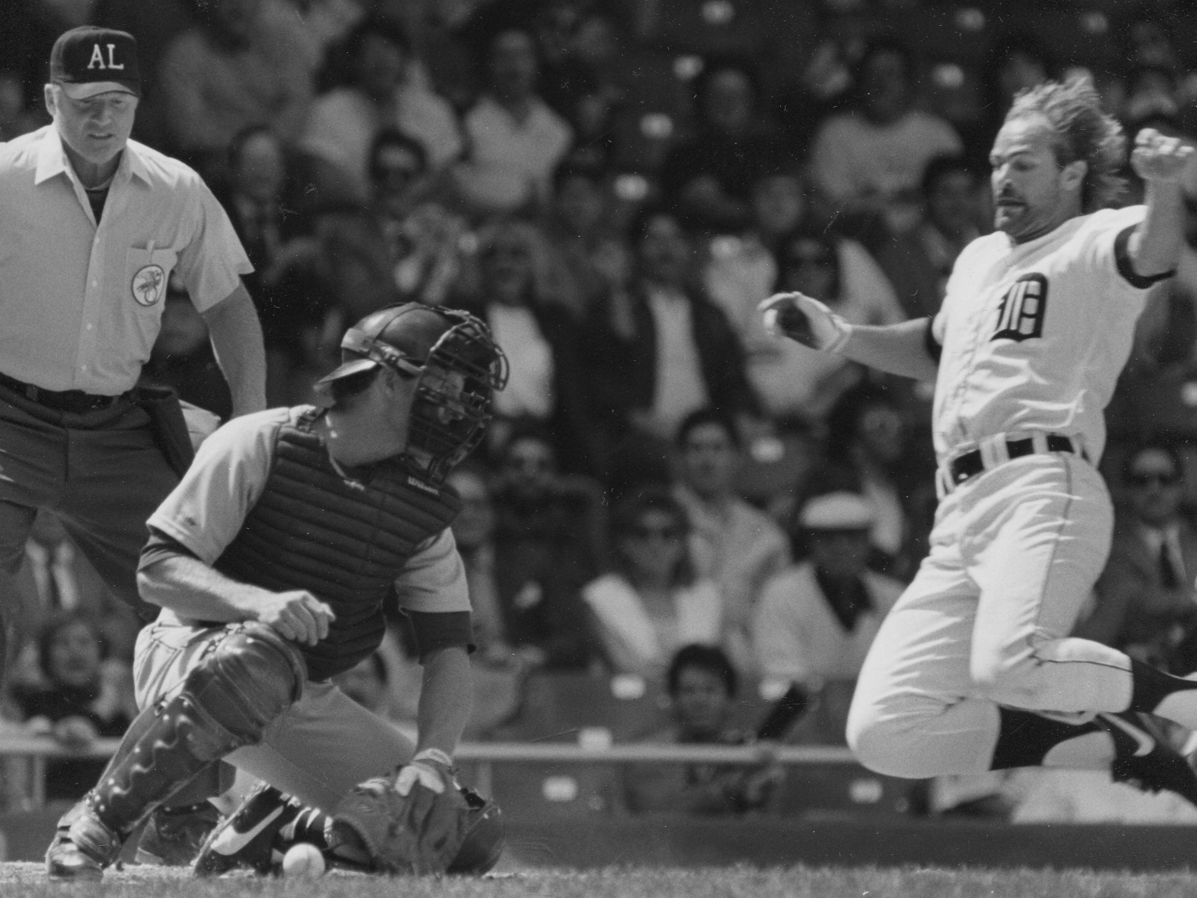 "Gibson launches himself toward home plate in a 1987 Tigers game. ""Trust me, I was really intense, have been my whole life, and I'm just trying to smell the roses as best I can, enjoy people a lot more,"" Gibson says."