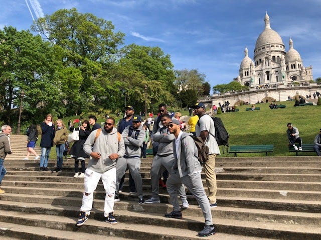 University of Michigan football players visit Sacre Coeur (The Basilica of the Sacred Heart of Paris) while sightseeing in Paris.