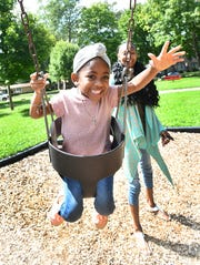 London Muldrow and her mother Laurice Henderson play at a park they like to visit. London was shot in the head at a west-side Detroit gas station as two men were arguing.
