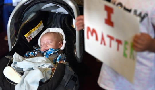 Christopher Brown, 2-months-old, is sound asleep during the press conference. He is the son of Ray Brown and his fiance, Nichole Skidmore. Pastor Charles E. Williams, II alleges Brown was holding Christopher when confronted by Westland police officers and eventually tazed.