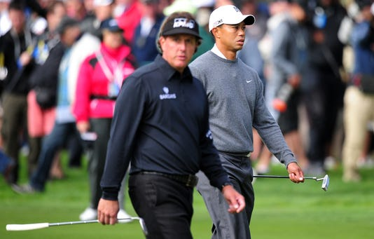 Phil Mickelson Walks Past Tiger Woods On