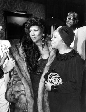 In this photo, taken by Jocelyn Brown in 1991, Aretha Franklin (left) wrapped in sable celebrates her 49th birthday along with fellow singer Mavis Staples of the Staple Singers at Aretha's birthday party.