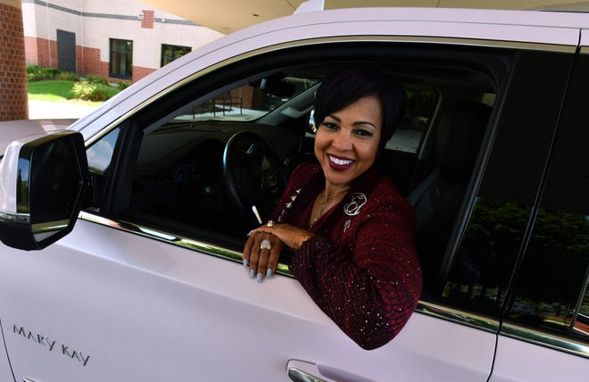 Greater Grace Temple first lady Crisette Ellis, in her pink Cadillac SUV, is organizing 100 pink Cadillacs to line Seven Mile in front of Greater Grace Temple for Aretha Franklin's funeral on Aug. 31 in Detroit.
