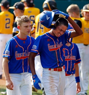 Grosse Pointe's Jarren Purify, right, and Cameron Schafer walk off the field after losing to Georgia.
