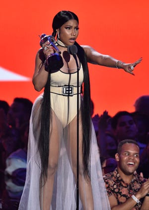 """Nicki Minaj accepts the award for best hip-hop video for """"Chun-Li"""" at the MTV Video Music Awards at Radio City Music Hall on Monday in New York."""