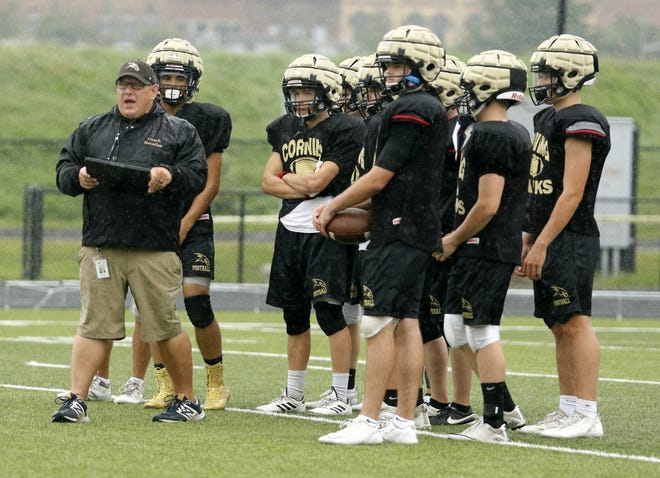 Corning head coach George Bacalles instructs his players during practice Aug. 22 at Corning-Painted Post High School.
