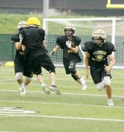 Corning practices kickoff returns during practice Aug. 22 at Corning-Painted Post High School.
