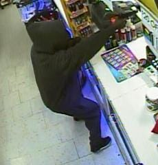 Evansville Police Department has asked for help identifying the man in this surveillance photo. The man is accused of robbing Sam's Food Mart on West Columbia Street this month.