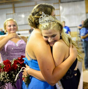 Regan Draeger, right, celebrates being crowned 2018 Sandusky County Junior Fair queen.