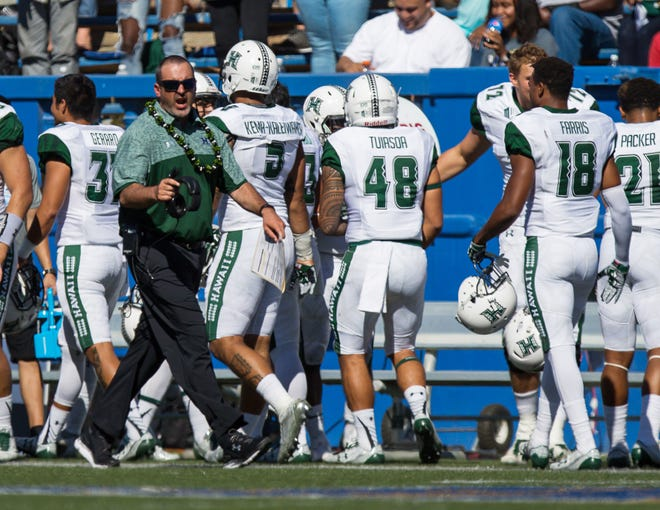 Hawaii's football team and coach Nick Rolovich, shown during a 2016 game at San Jose State, were scheduled to travel to Colorado on Wednesday night, a day before the expected arrival of Hurricane Lane on the islands, for Saturday's game at CSU.