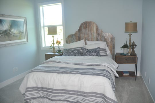 Each guest bedroom has its own unique style. This headboard is restored wood.