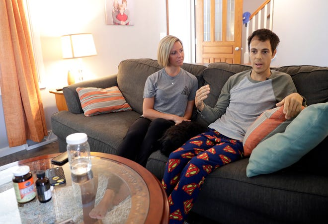 Brian Schroeder, Green Bay Action Sports Organization founder, and his wife, Mandy, discuss Brian's battle with a brain tumor and future goals for the indoor skate park on Aug. 20 while sitting in the living room of their Allouez home.