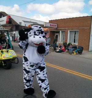 A symbol of the area's dairy heritage makes it way down the route in last year's Dairyfest Parade. Dairyfest is celebrated in Lena again on Saturday Sept. 8