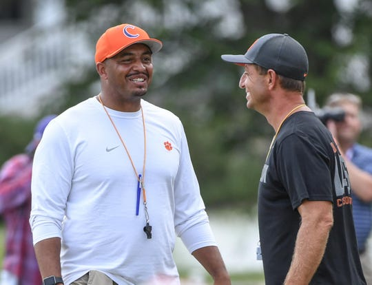 Clemson co-offensive coordinator Tony Elliott, left, and head coach Dabo Swinney during practice at Clemson University on Tuesday, August 21.