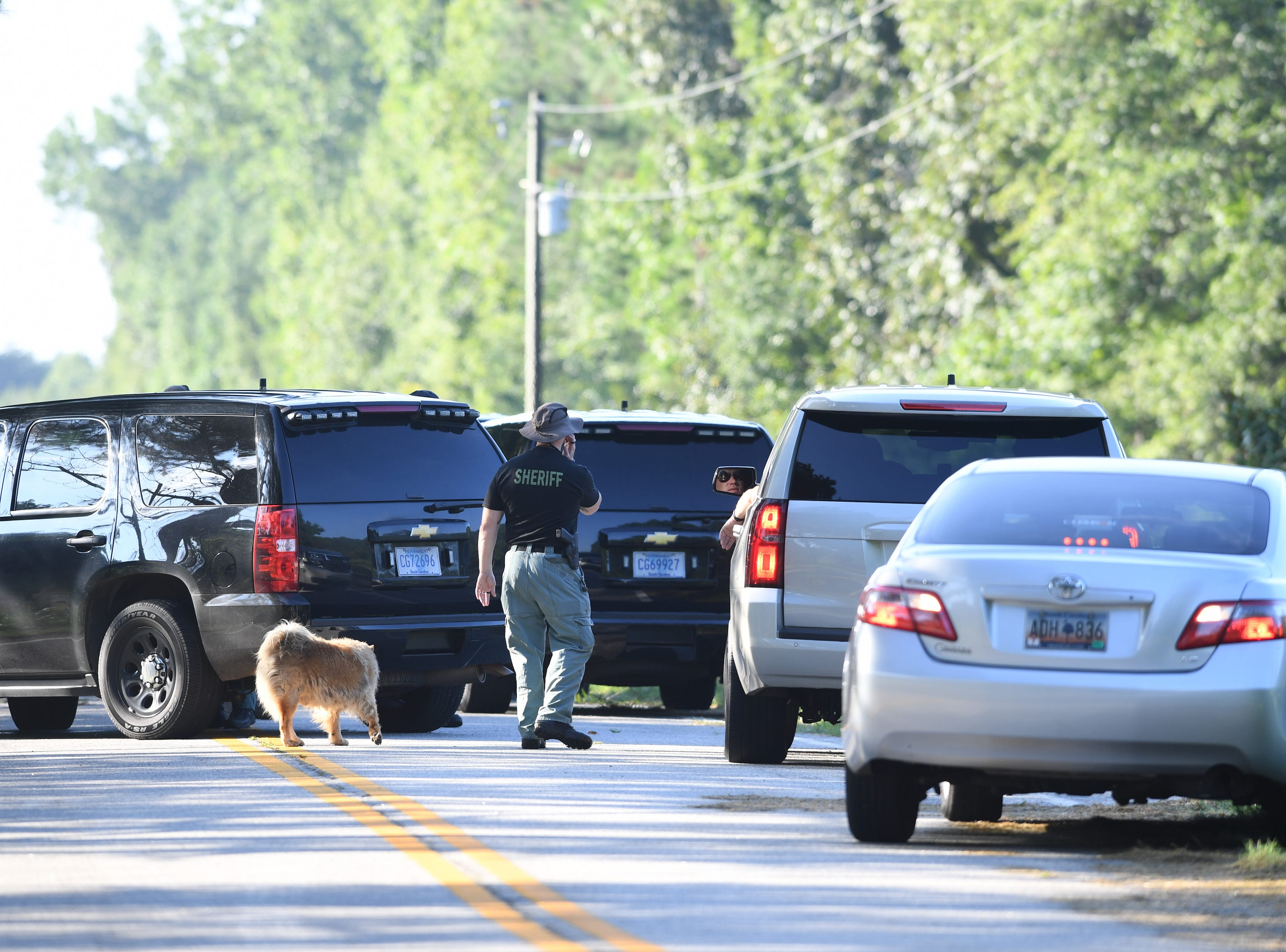 Spartanburg County Sheriff's Office deputies gather in Enoree on Wednesday, Aug. 22, 2018, during a search for possible bodies that serial killer Todd Kohlhepp claims he buried.