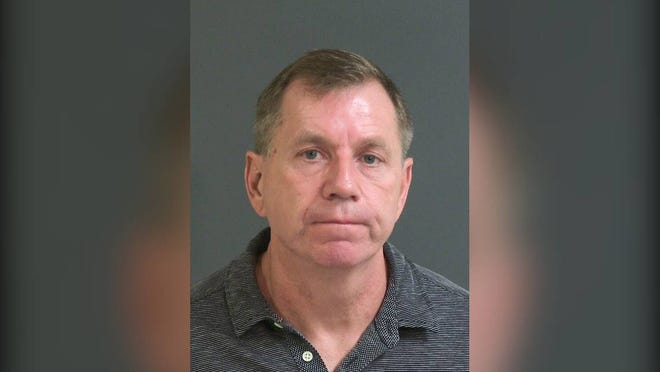 Kenneth Boes, a staff member at The Citadel, surrendered to state agents Wednesday on charges of criminal sexual conduct and providing beer or alcohol to persons under 21, officials said.