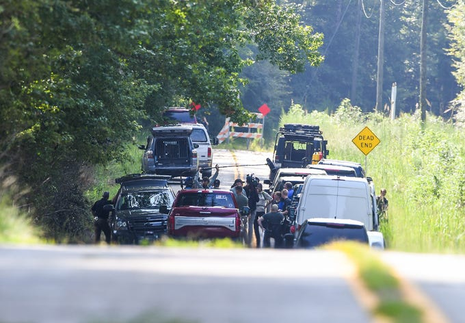 Spartanburg County investigators, after receiving a tip, search for additional homicide victims of serial killer Todd Kohlhepp off I-26 in Enoree Wednesday, August 22, 2018.