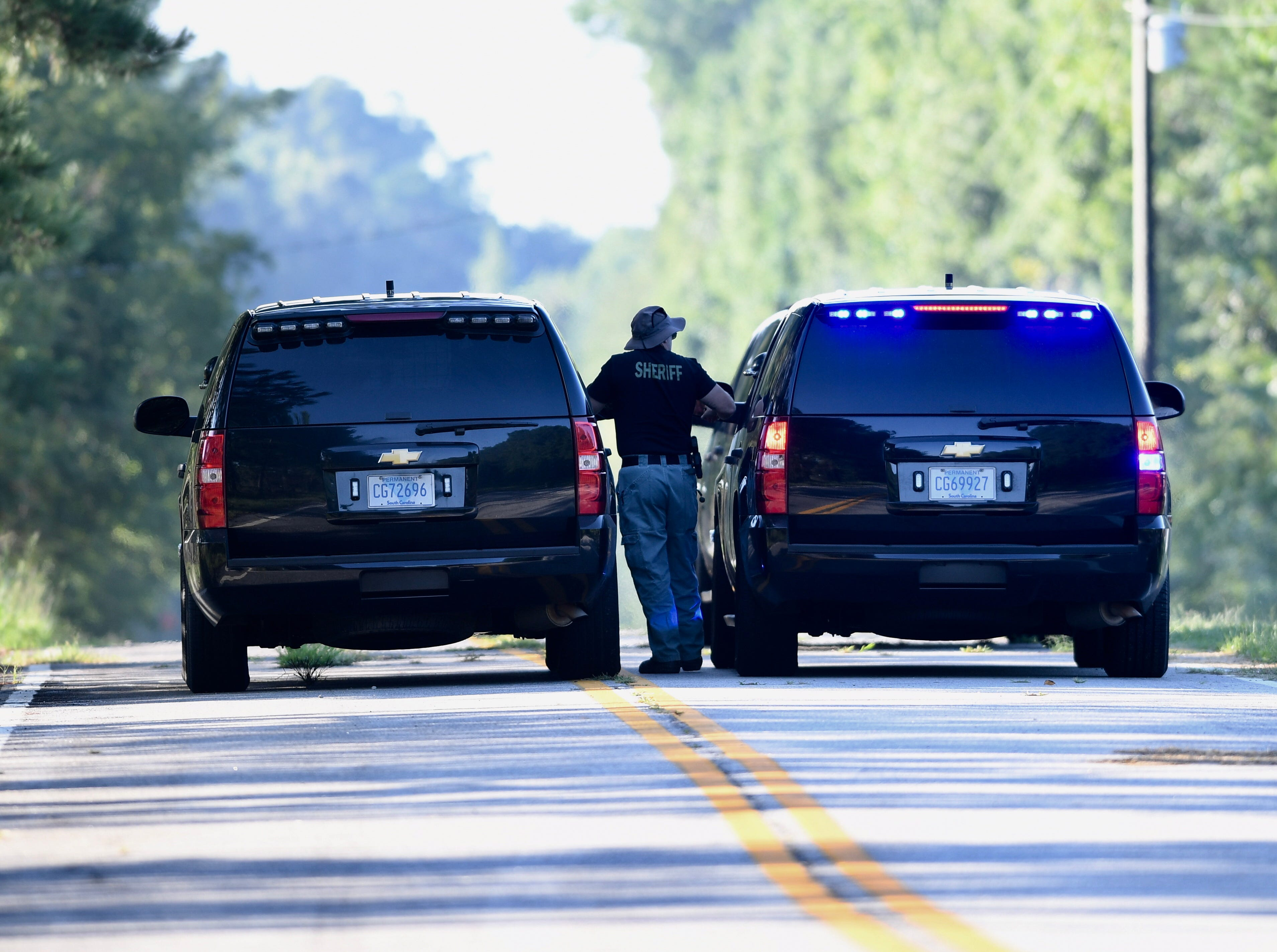 Spartanburg County deputies at Summer Road in Enoree as they begin a search on Wednesday, Aug. 22, 2018, for bodies of two victims that Todd Kohlhepp claimed he had buried.