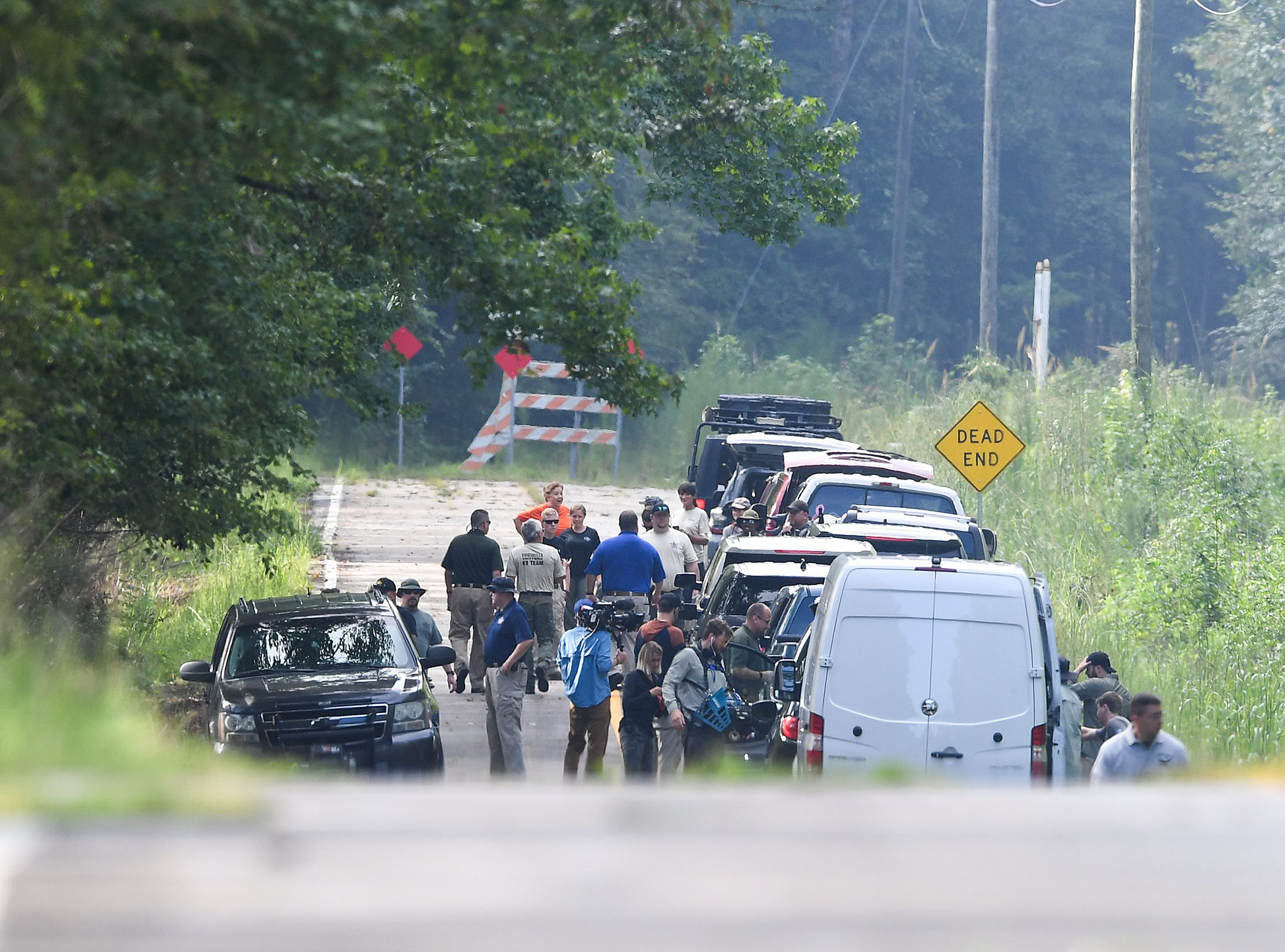 A documentary film crew arrives on the scene in Enoree of I-26 where Spartanburg County investigators, after receiving a tip, search for additional homicide victims of serial killer Todd Kohlhepp Wednesday, August 22, 2018.