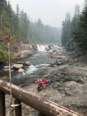 A sprinkler is set up on a bridge in Glacier National Park as part of the work to fight the Howe Ridge Fire.