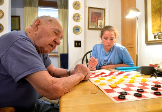 Ed Bucko, who turned 104 years old recently, and his great-granddaughter Keely Dirkson give a demonstration of the checker-chess hybrid game that he invent in the 60's called King Check.