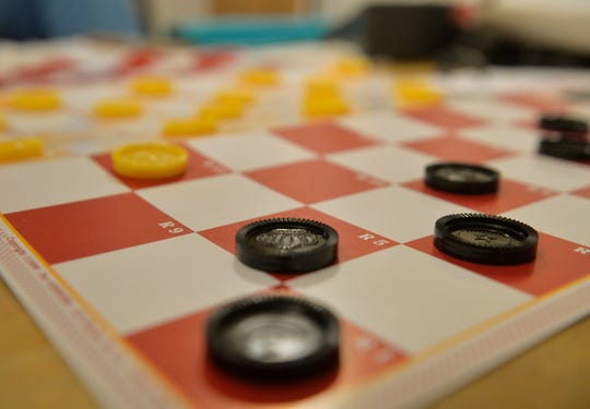 King Check game board set up for a game.  The board game, which is a checkers-chess hybrid, was invented by Ed Bucko of Great Falls in 1969.