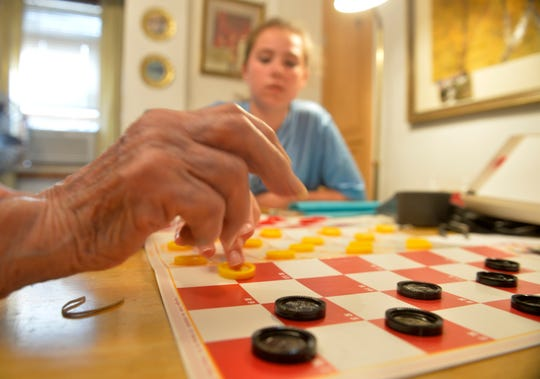 Ed Bucko, who turned 104 years old recently, gives a demonstration of the checker-chess hybrid game he invented in 1969 called King Check.