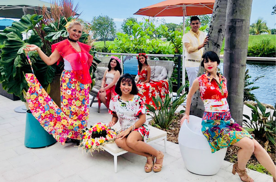 The Guam John Robert Powers models rest by the river walk at the Sheraton in Miami Florida during the Modeling Association of America International competitions. The Guam models wore an island design by Wendy of Smart Cut at the Chamorro Village. Pictured from left: Rochella Perez, Melody Manluck and Rolani Pannullo. Back left: Analina Dial, Myrna Murphy and Marlon Hannigan.