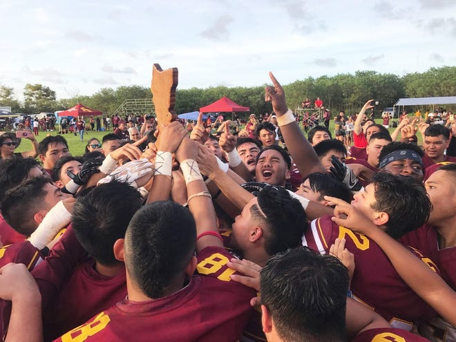 In this file photo, the Father Duenas Friars celebrate their 34-0 victory over the George Washington Geckos for the 2017 IIAAG High School Football title. The Friars and Geckos again face off in PDN Game of the Week on Friday.