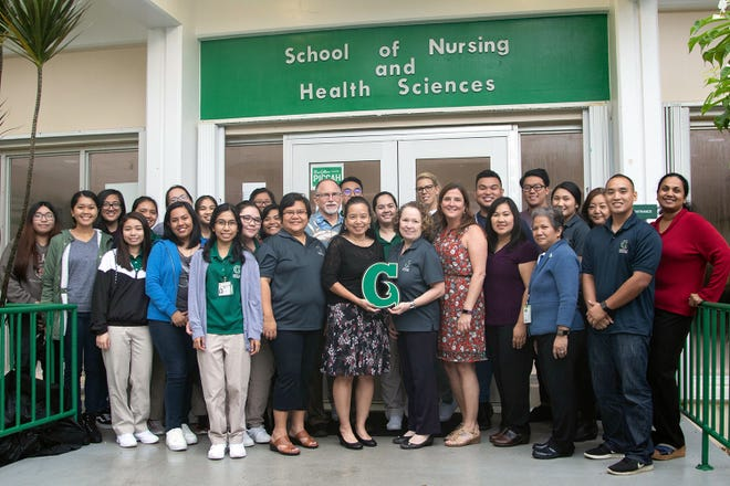 Faculty, staff, and students of the University of Guam School of Nursing and Health Sciences celebrate the nursing program's reaccreditation.