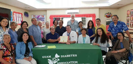 The Guam Diabetes Association conducted its free monthly  Diabetes Education Session on August 14 at the Mangilao Senior Center. The Guest Speaker was Dr. Phillip Tutnauer, DPM from Guam Regional Medical Center.  Pictured is Scott Duenas , GDA president, presenting a Certificate of Recognition to Dr. Tutnauer and the participants.