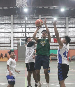 Shawn Biven of Etures goes up for a shot in a game against Yes Dear in high school action during the Federated States of Micronesia Association Aug. 19 at the Astumbo Gym in Dededo.