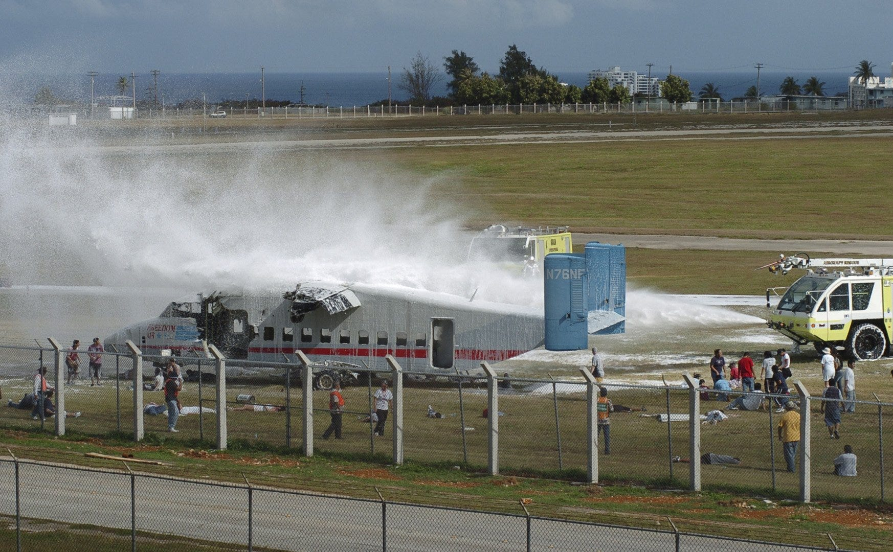 In this file photo, airport fire trucks spray an airplane during emergency response training at the A.B. Won Pat Guam International Airport. The airport got a grant for more than $15.9 million to construct a new aircraft rescue and firefighting building.