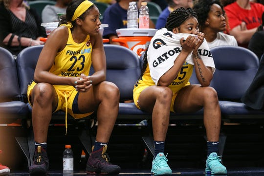Fever forward Stephanie Mavunga, left, and guard Victoria Vivians watched as the Fever lost in overtime to Las Vegas.