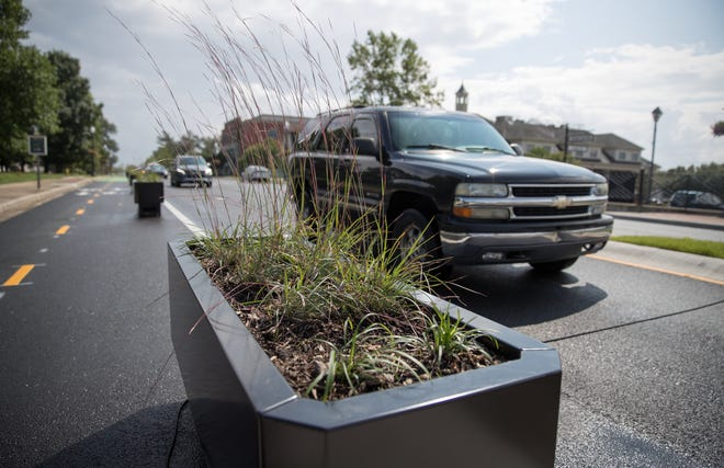 Planter boxes that have been installed along Range Line Road in Carmel, Tuesday, Aug. 21, 2018. These boxes, numbering 40, cost the city $3,550 each, and are placed as a border between the automobile road and newly installed bike lanes.
