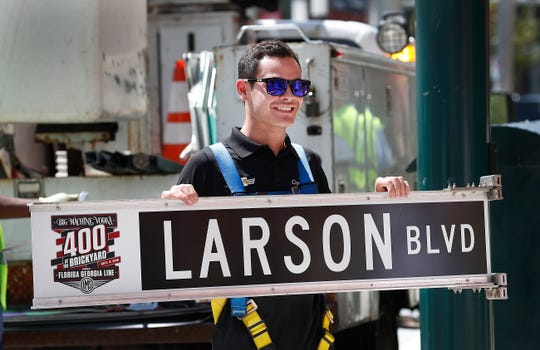 Kyle Larson gets his own street  sign at the corner of Illinois and Georgia Street in Indianapolis.